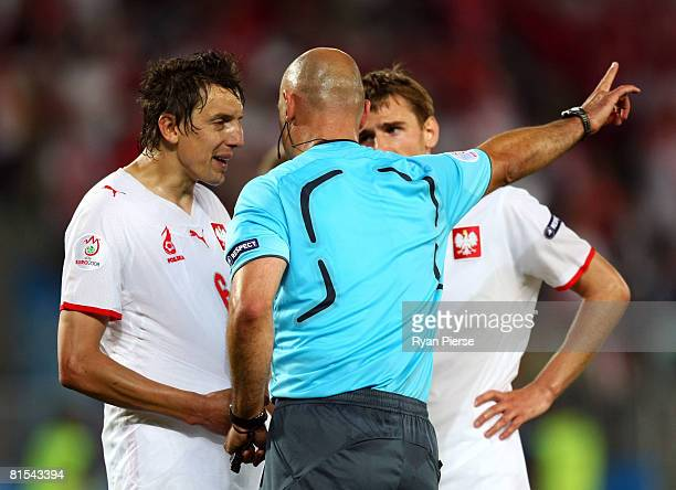 Referee Howard Webb of England speaks to Jacek Bak of Poland after he awards a penalty in the final minute during the UEFA EURO 2008 Group B match...
