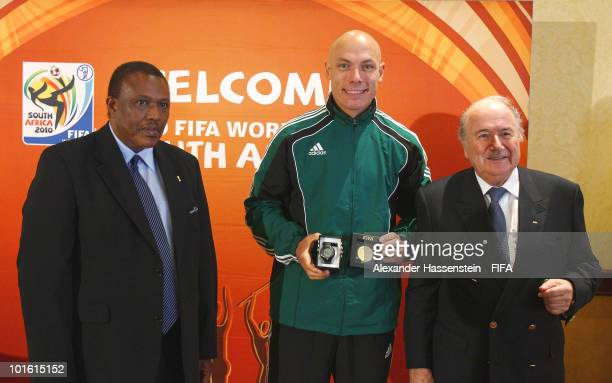 Referee Howard Webb of Great Britian pose with FIFA president Joseph S Blatter and organising chairman Irvin Khoza during the welcome and opening...