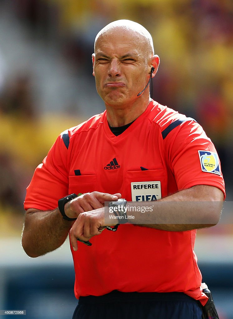 Referee Howard Webb points to his watch during the 2014 FIFA World Cup Brazil Group C match between Colombia and Cote D'Ivoire at Estadio Nacional on June 19, 2014 in Brasilia, Brazil.