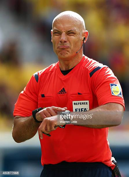 Referee Howard Webb points to his watch during the 2014 FIFA World Cup Brazil Group C match between Colombia and Cote D'Ivoire at Estadio Nacional on...