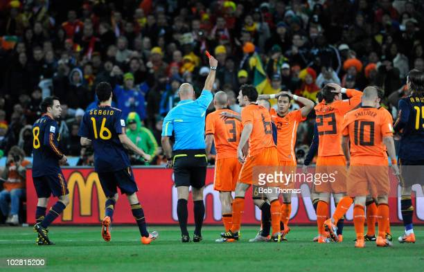 Referee Howard Webb shows the red card and sends off John Heitinga of the Netherlands during the 2010 FIFA World Cup Final between the Netherlands...