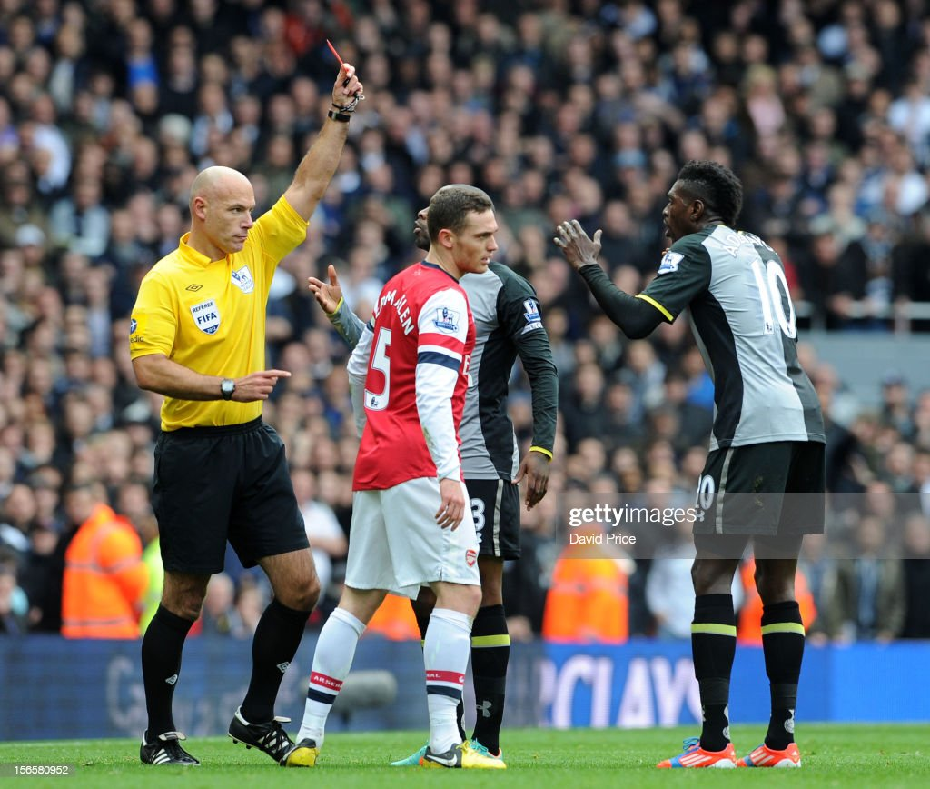 Referee Howard Webb shows the Red Card to Emmanuel Adebayor of Tottenham during the Barclays Premier League match between Arsenal and Tottenham Hotspur, at Emirates Stadium on November 17, 2012 in London, England.