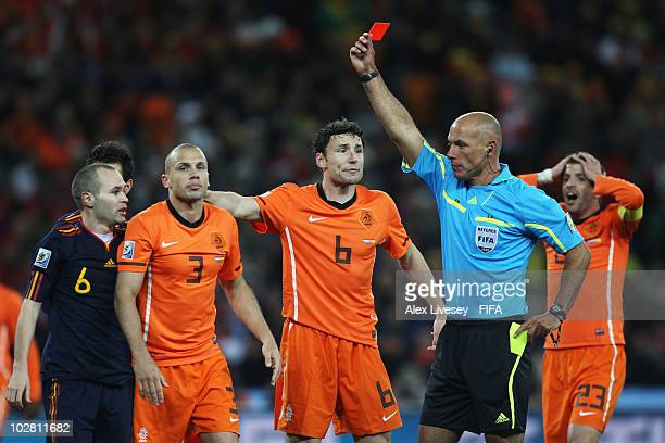 Referee Howard Webb shows the red card to John Heitinga of the Netherlands during the 2010 FIFA World Cup South Africa Final match between...