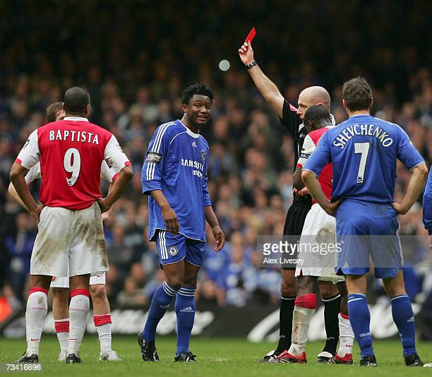 Referee Howard Webb shows the red card to Mikel John Obi of Chelsea during the Carling Cup Final match between Chelsea and Arsenal at the Millennium...