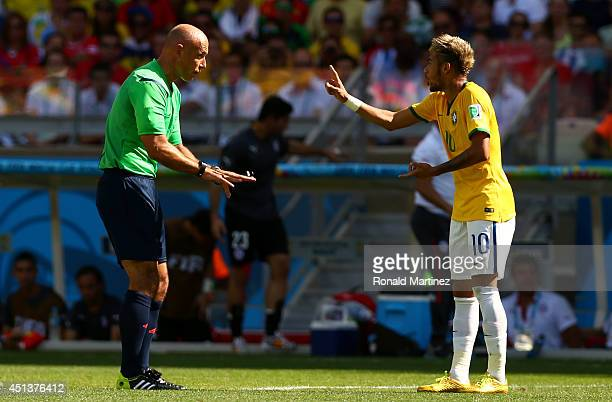 Referee Howard Webb speaks to Neymar of Brazil during the 2014 FIFA World Cup Brazil round of 16 match between Brazil and Chile at Estadio Mineirao...
