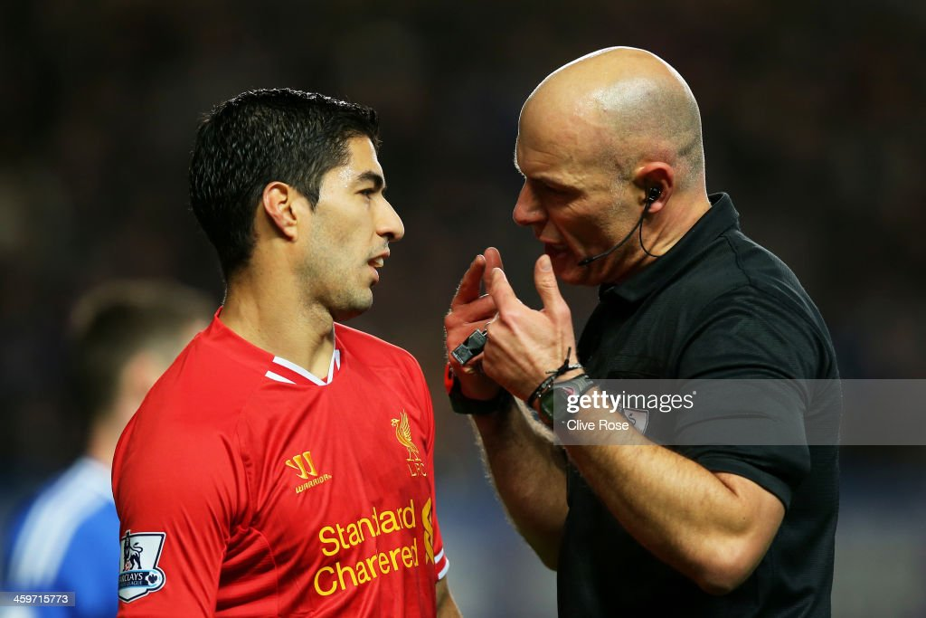 Referee Howard Webb speaks with Luis Suarez of Liverpool during the Barclays Premier League match between Chelsea and Liverpool at Stamford Bridge on December 29, 2013 in London, England.