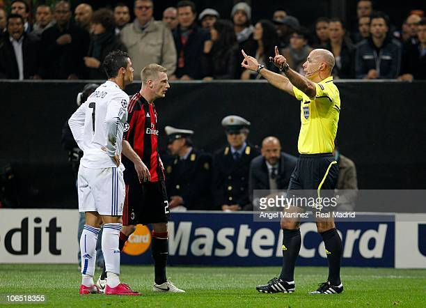 Referee Howard Webb talks to Cristiano Ronaldo of Real Madrid and Ignazio Abate of AC Milan during the UEFA Champions League Group G match between AC...
