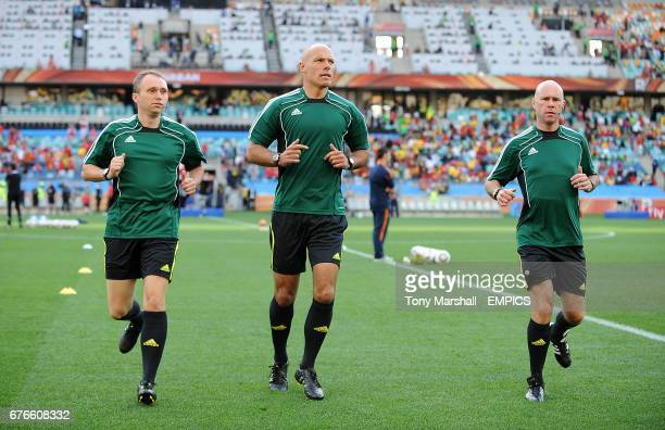 Referee Howard Webb warms up with his assistants Darren Cann and Mike Mullarkey prior to kick off