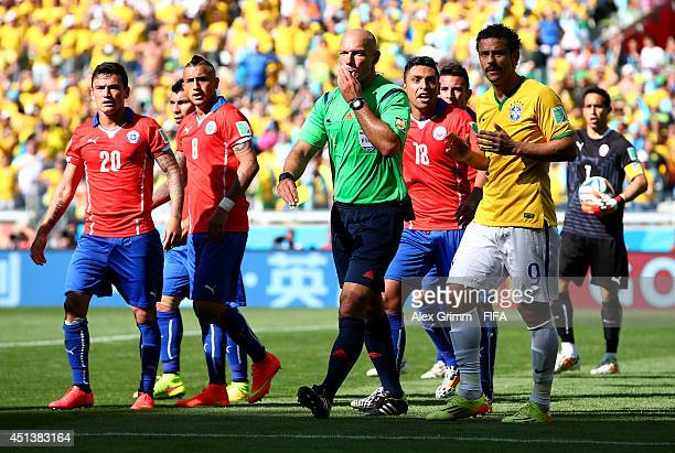 Referee Howard Webb whistles to disallow the goal by Hulk due to a hand ball during the 2014 FIFA World Cup Brazil Round of 16 match between Brazil...