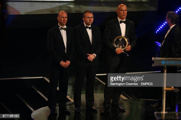 Referee Howard Webb winner of the special merit award and assistant's Darren Cann and Michael Mullarkey during the 2011 PFA Player of the Year Awards...