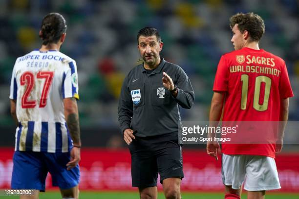 Referee Hugo Miguel gestures during the Portuguese Super Cup match between FC Porto and SL Benfica at Estadio Municipal de Aveiro on December 23,...