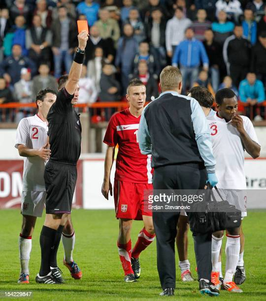 Referee Huseyin Gocek shows the red card to Danny Rose of England after the Under 21 European Championship Play Off second leg match between Serbia...