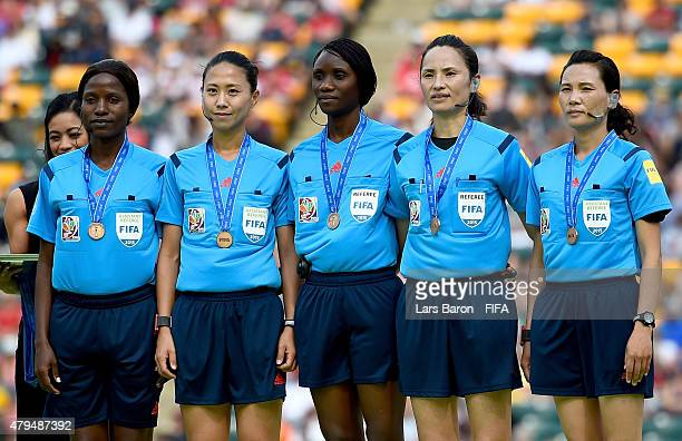 Referee Hyang Ok Ri and her assistants pose for a picture after the FIFA Women's World Cup 2015 Third Place Playoff match between Germany and England...
