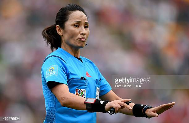 Referee Hyang Ok Ri gestures during the FIFA Women's World Cup 2015 Third Place Playoff match between Germany and England at Commonwealth Stadium on...