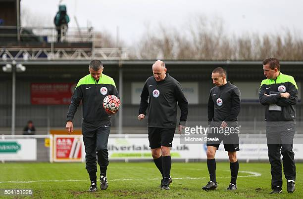 Referee Iain Williamson and officials inspect the pitch condition prior to the Emirates FA Cup third round match between Eastleigh and Bolton...