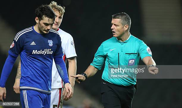 Referee Iain Williamson makes a point to Tony Watt of Cardiff City during the Sky Bet Championship match between Milton Keynes Dons and Cardiff City...