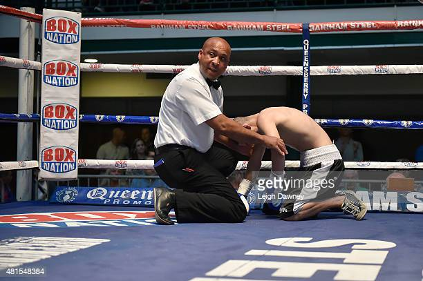 Referee Ian john Lewis seeks medical assistance after Tibor Nador was knocked down by Jay Harris during their Super Bantamweight bout at York Hall on...