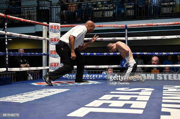 Referee Ian john Lewis starts a counting Tibor Nador after he was knocked down by Jay Harris during their Super Bantamweight bout at York Hall on...