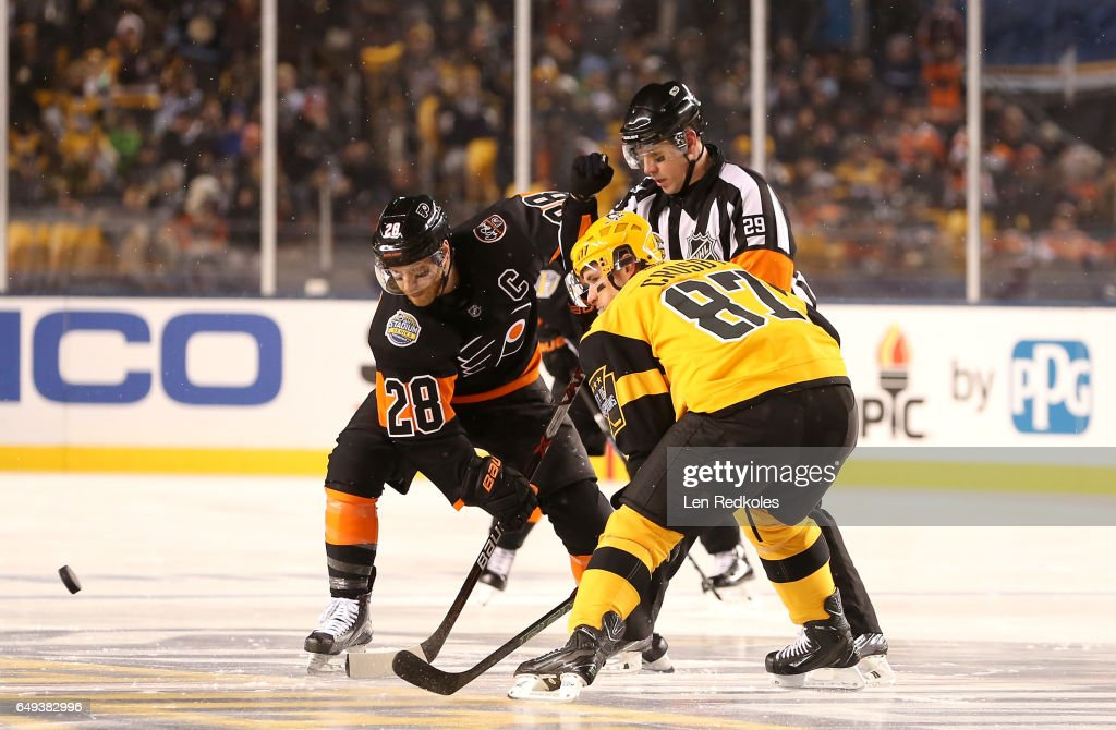 NHL referee Ian Walsh #29 drops the puck between Claude Giroux #28 of the Philadelphia Flyers and Sidney Crosby #87 of the Pittsburgh Penguins for the opening face-off of the 2017 Coors Light NHL Stadium Series at Heinz Field on February 25, 2017 in Pittsburgh, Pennsylvania.