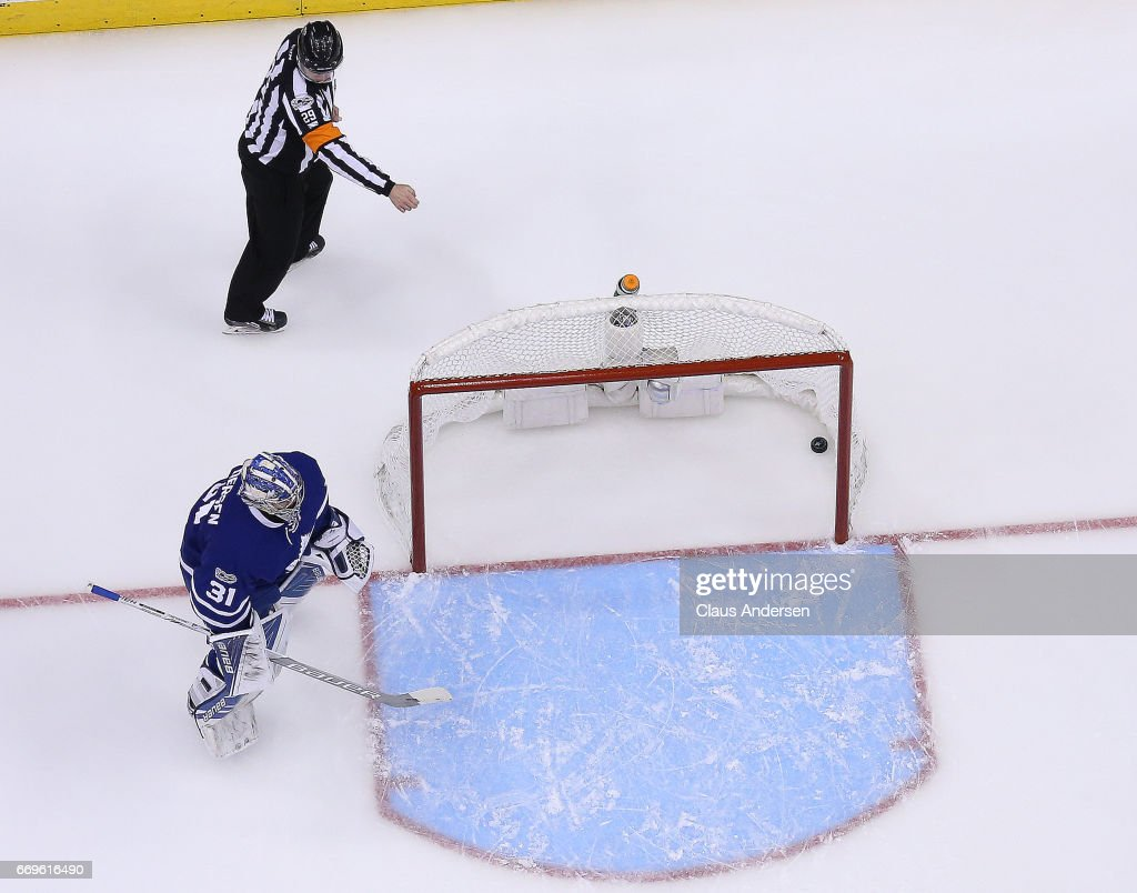Referee Ian Walsh #29 signals a goal past Frederik Andersen #31 of the Toronto Maple Leafs during play against the Washington Capitals in Game Three of the Eastern Conference Quarterfinals during the 2017 NHL Stanley Cup Playoffs at the Air Canada Centre on April 17, 2017 in Toronto, Ontario, Canada. The Maple Leafs defeated the Capitals 4-3 in overtime.