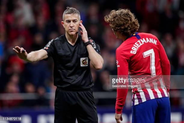 referee Iglesias Villanueva Antoine Griezmann of Atletico Madrid during the La Liga Santander match between Atletico Madrid v Girona at the Estadio...