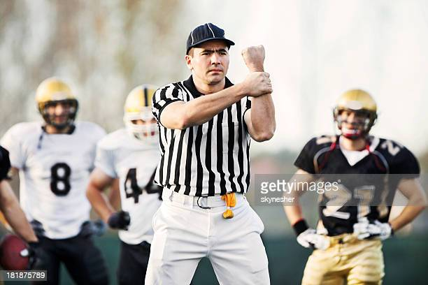 referee: illegal use of hands. - american football referee stock pictures, royalty-free photos & images