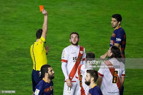 Referee Inaki Vicandi Garrido shows the red card to Joaquin Jose Marin alias Quini of Rayo Vallecano de Madrid during the La Liga match between Rayo...