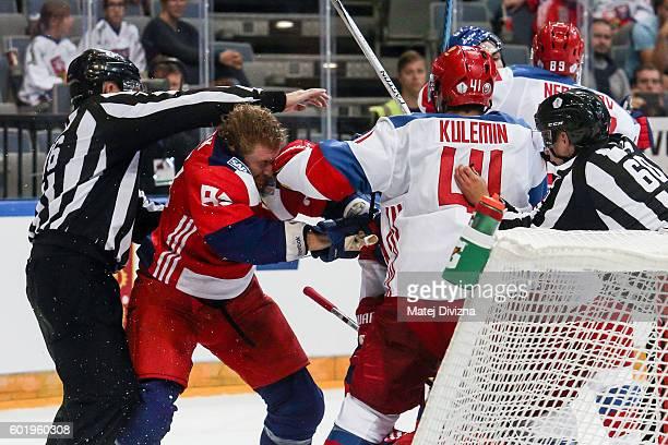 A referee intervenes in a scuffle between Jakub Voracek of Czech Republic and Nikolay Kulemin of Russia during the 2016 World Cup of Hockey...