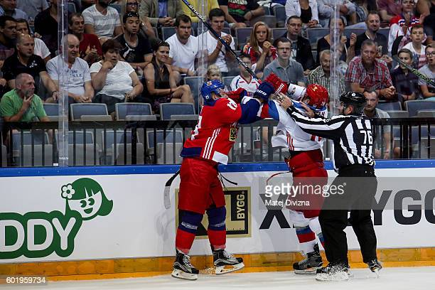A referee intervenes in a scuffle between Ondrej Palat of Czech Republic and Alexei Emelin of Russia during the 2016 World Cup of Hockey preparation...