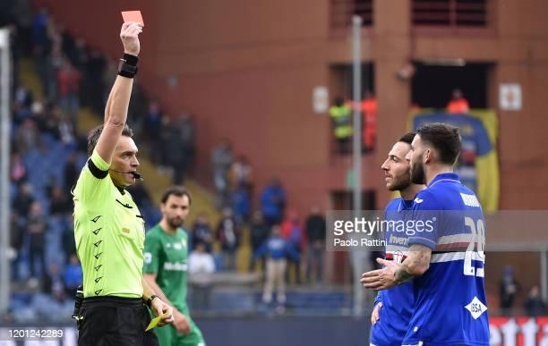 Referee Irrati shows a red card to Nicola Murru of UC Sampdoria during the Serie A match between UC Sampdoria and ACF Fiorentina at Stadio Luigi...