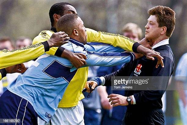 A referee is attacked during an amateur football match at Hackney Marshes on April 25th 2004 in Hackney London An image from the book 'In The Moment'...