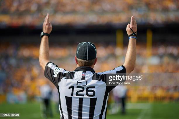 A referee is seen signaling a touchdown during an NFL football game between the Minnesota Vikings and the Pittsburgh Steelers on September 17 2017 at...