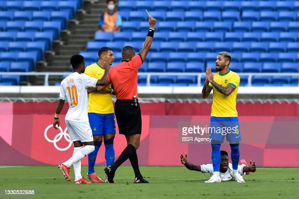 Referee Ismail Elfath of USA shows a yellow card to Douglas Luiz of Brazil during the Tokyo 2020 Olympic Mens Football Tournament match between...