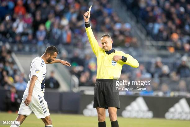 Referee Ismail Elfath sends off Ashley Cole of Los Angeles Galaxy for his second yellow card offence after his foul on David Villa of New York City...