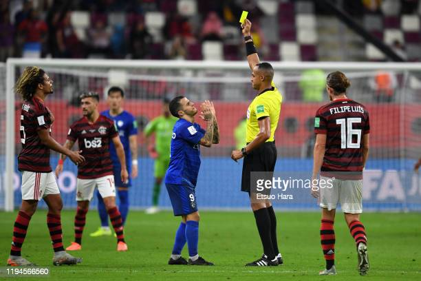 Referee Ismail Elfath shows a yellow card to Sebastian Giovinco of Al Hilal during the FIFA Club World Cup Qatar Semifinal between CR Flamengo and Al...