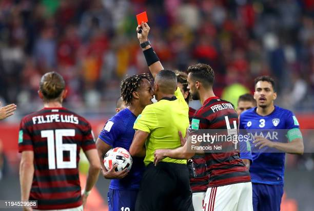 Referee Ismail Elfath shows Andre Carrillo of Al Hilal SFC a red card during the FIFA Club World Cup semifinal match between CR Flamengo and Al Hilal...