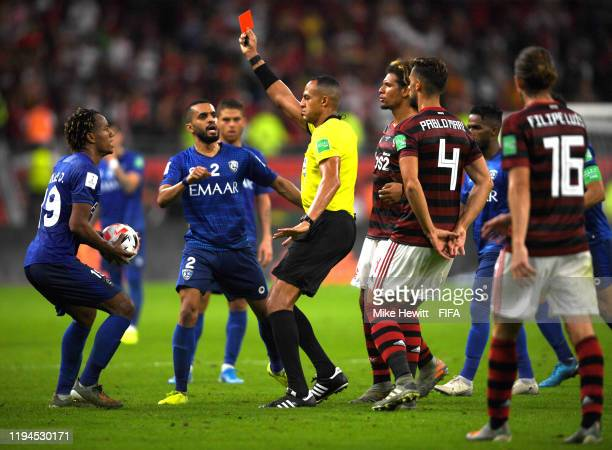 Referee Ismail Elfath shows Andre Carrillo of Al Hilal SFC a red card during the FIFA Club World Cup semi-final match between CR Flamengo and Al...