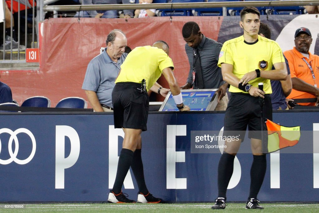 Referee Ismail Elfath watches a video replay during an MLS match between the New England Revolution and Vancouver Whitecaps FC on August 12, 2017, at Gillette Stadium in Foxborough, Massachusetts. The Revolution defeated the Whitecaps 1-0.