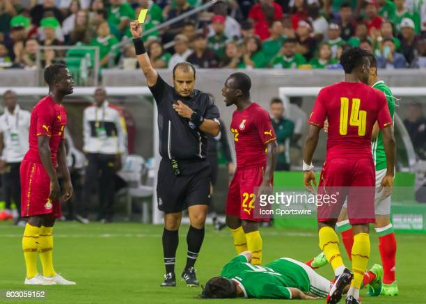 Referee issues a yellow card to Ghana midfielder Frank Acheampong during the Mexico vs Ghana friendly soccer match at on June 28 2017 at NRG Stadium...