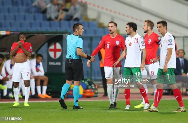 Referee Ivan Bebek speaks with Jordan Henderson and Harry Kane of England along with Ivelin Popov of Bulgaria during the UEFA Euro 2020 qualifier...
