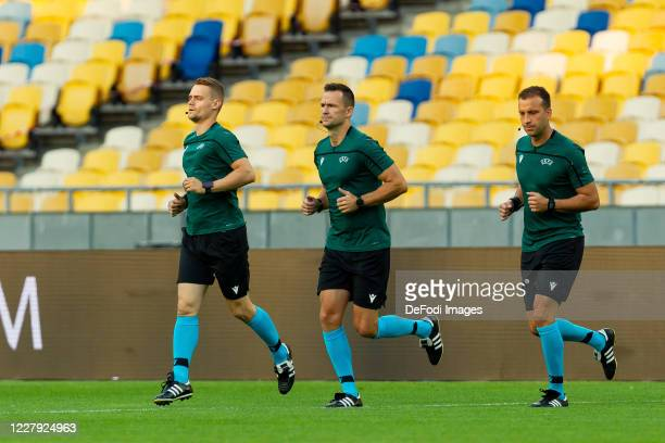 Referee Ivan Kruzliak looks on prior to the UEFA Europa League round of 16 second leg match between Shakhtar Donetsk and VfL Wolfsburg at Metalist...