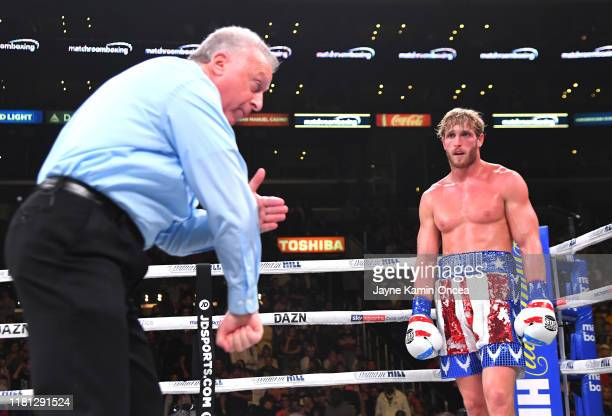 Referee Jack Reiss deducts 2 points from the score card of Logan Paul after he punched KSI after a knock down in their pro debut fight at Staples...