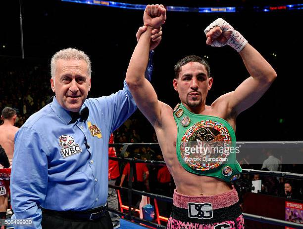Referee Jack Reiss holds up the hand of Danny Garcia after he defeated Robert Guerrero on unanimous decision to win the WBC championship welterweight...
