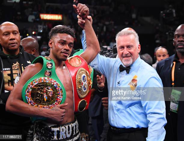 Referee Jack Reiss in in the ring with Erroll Spence Jr. After he defeated Shawn Porter in their IBF & WBC World Welterweight Championship fight at...
