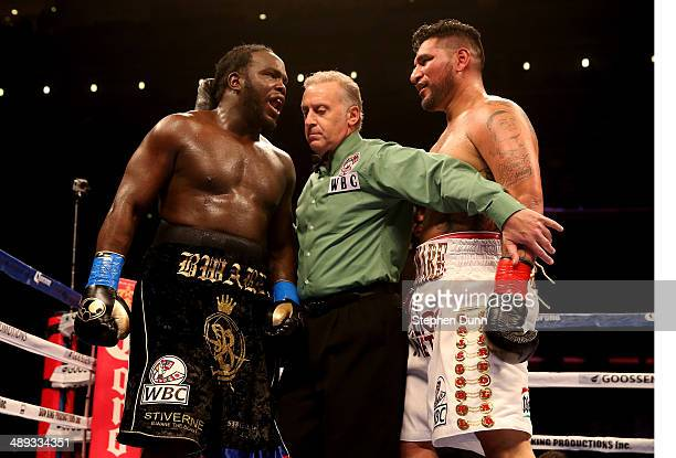 Referee Jack Reiss separates Bermane Stiverne Chris Arreola at the end of the fourth round of their WBC Heavyweight Championship match at Galen...