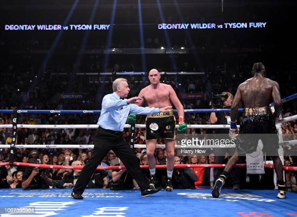 Referee Jack Reiss signals the end of the fight to Tyson Fury and Deontay Wilder ending in a draw during the WBC Heavyweight Championship at Staples...