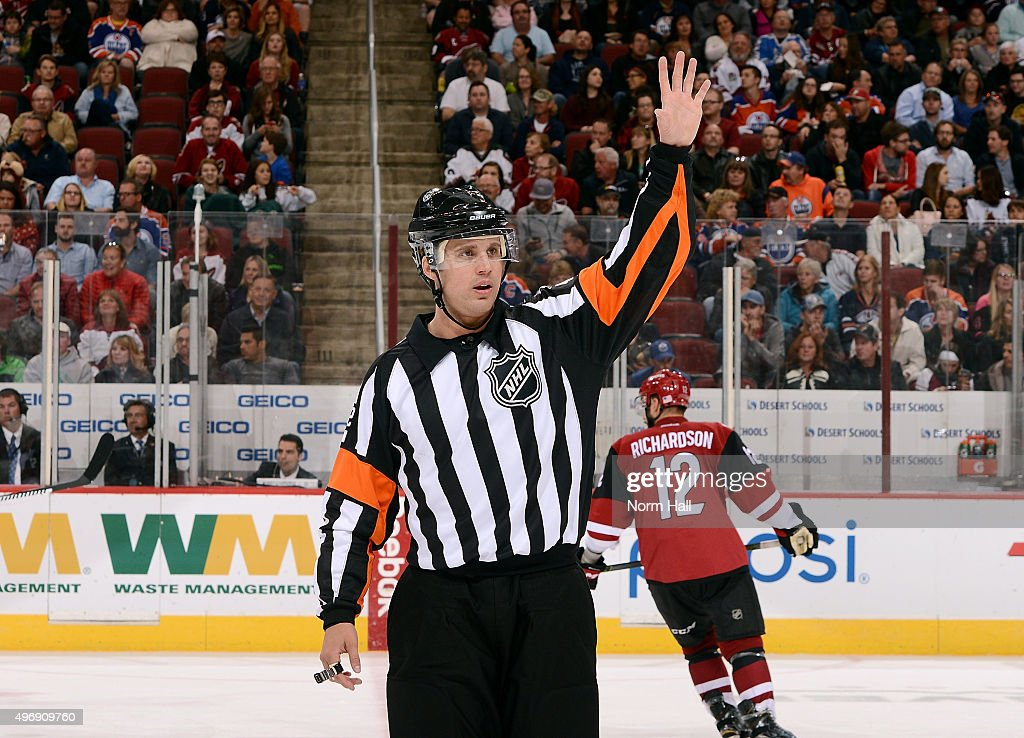 Referee Jake Brenk officiates a game between the Arizona Coyotes and Edmonton Oilers at Gila River Arena on November 12, 2015 in Glendale, Arizona. It was Brenk's first NHL game.