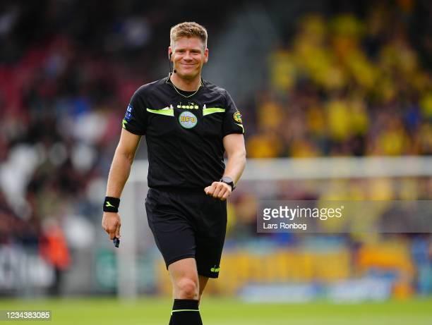 Referee Jakob Alexander Sundberg smiling during the Danish 3F Superliga match between Vejle Boldklub and Brondby IF at Vejle Stadion on August 1,...