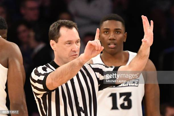 Referee James Breeding calls a foul during the Big East Basketball Tournament Quarterfinal game between the Providence Friars and the Creighton...