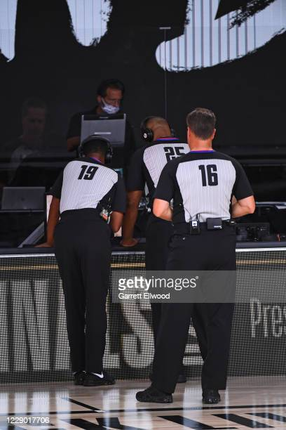 Referee James Capers, referee Tony Brothers, referee David Guthrie look at a replay during Game Six of the NBA Finals on October 11, 2020 at the...